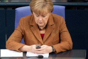 Mutti checks her mobile